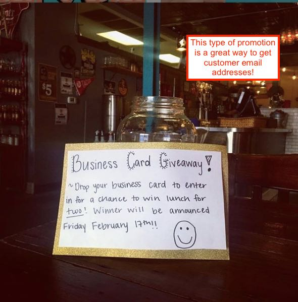 Sign promoting a business card drawing at a restaurant